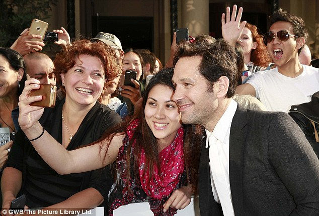 Snap happy: The 46-year-old actor was his usual down-to-earth self and posed for endless pictures with fans