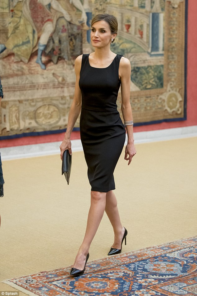 Queen Letizia showcased her slimline figure in a sleeveless black cocktail dress at an event in Madrid on Wednesday evening as she joined the President of Peru Ollanta Humala gala dinner