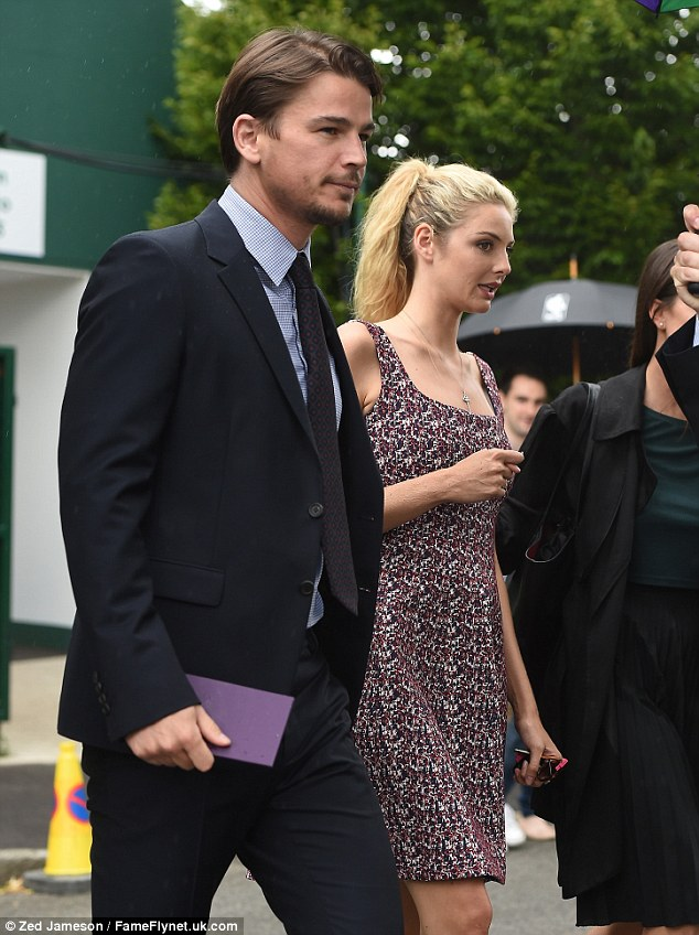 Chic: Tamsin opted for a sleeveless summer dress which flowed to just above her knees and she paired it with purple heels while Josh was dapper in a dark suit