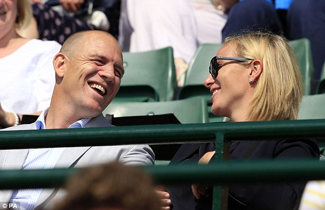 The husband and wife looked delighted to be spending the day watching tennis