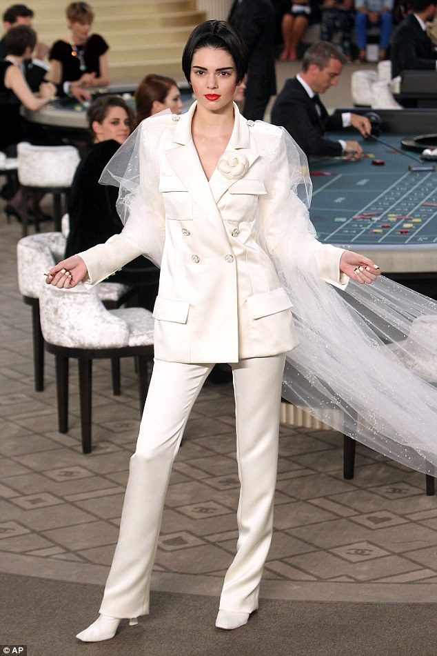 Unrecognisible: Kendall Jenner also walked the runway in astructured off-white satin suit