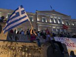 A woman waves a Greek flag during an anti-austerity pro-government rally in front of the parliament building in Athens, Greece, June 21, 2015. Greece's leftwing government believes it can reach a deal with its creditors, Finance Minister Yanis Varoufakis said on Sunday after almost eight hours of meetings to thrash out proposals ahead of a last-ditch summit with European leaders on Monday. REUTERS/Marko Djurica