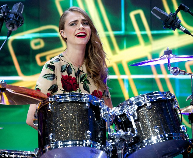 Put on the spot: Cara Delevingne was tasked with playing the drums while making an appearance on a Spanish chat show on Wednesday