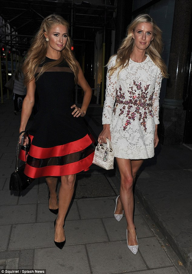 Stunning display: The Hilton heiresses both flaunted their lovely legs in short dresses and heels, a bodily asset they clearly have in common