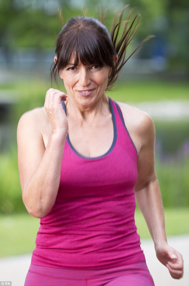 Working out! Davina looked the epitome of fitness on Wednesday, dressed in a fuchsia gym outfit