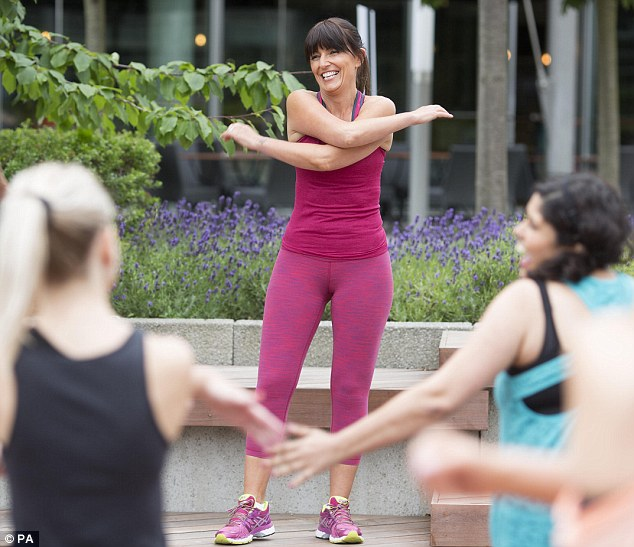 Beaming with pride: The DVD release comes as Davina has teamed up with her personal trainer Ed Lumsden to create ten new seven-minute workouts that will help those with hectic lifestyles to get in shape