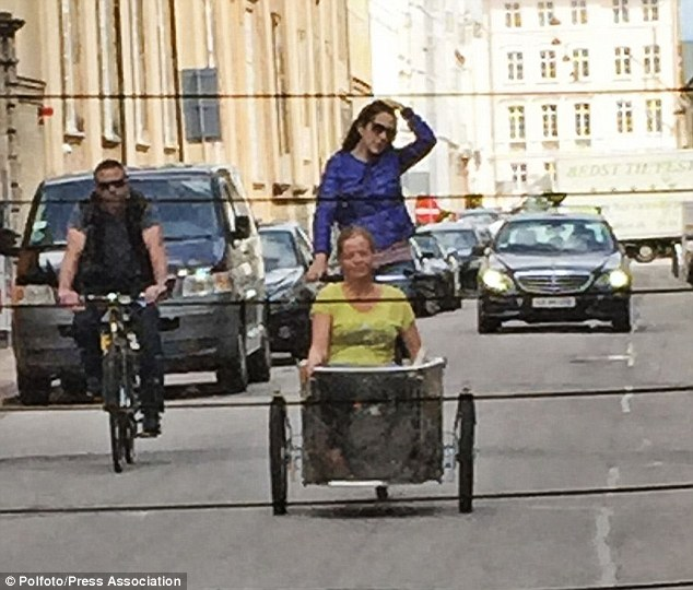Not your average cyclist: Crown Princess Mary was spotted riding a cargo bike around Copenhagen recently, with a member of staff sitting in the cart in front