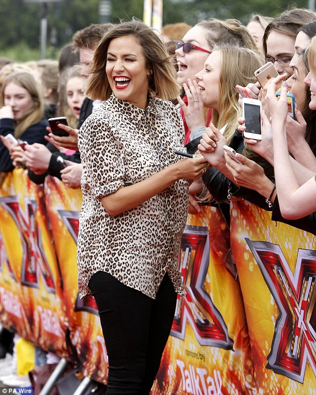 Host with the most! Caroline, 35, showed off her animal instinct in a leopard print shirt teamed with black jeans