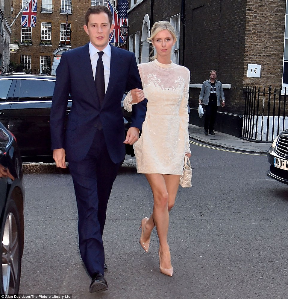 Happy couple: James Rothschild and Nicky Hilton arrive at their pre-wedding party yesterday