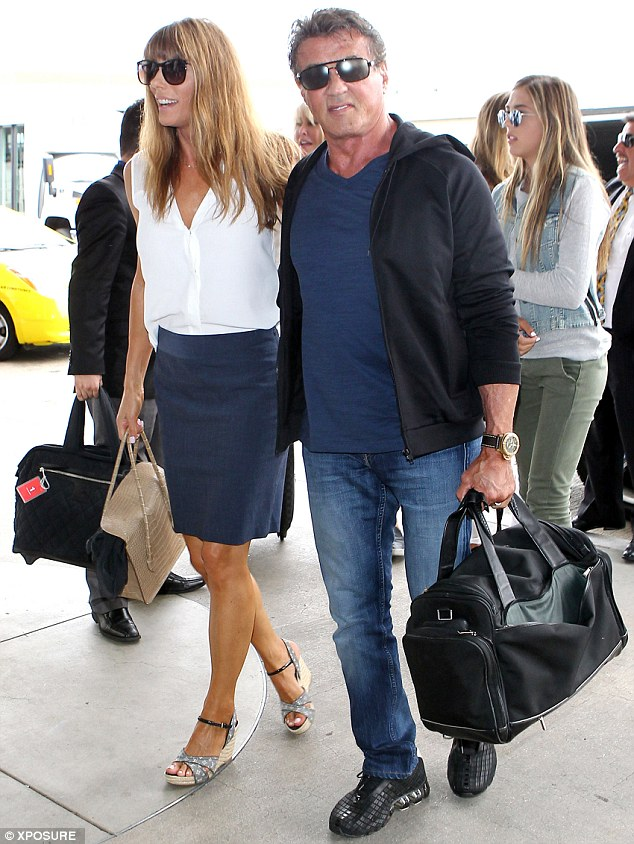 Proud as punch: Sylvester Stallone celebrated his 69th birthday on Monday, and couldn't look happier as he jetted out of LAX with his wife and daughters two days later, on Wednesday