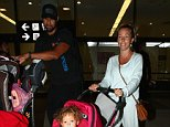 Los Angeles, CA - Kendra Wilkinson, her husband Hank Baskett and daughter Alijah make their way through LAX. The mother-of-two went makeup free and dressed comfortably in a light sweatshirt and matching sweatpants. AKM-GSI    July  9, 2015 To License These Photos, Please Contact : Steve Ginsburg (310) 505-8447 (323) 423-9397 steve@akmgsi.com sales@akmgsi.com or Maria Buda (917) 242-1505 mbuda@akmgsi.com ginsburgspalyinc@gmail.com