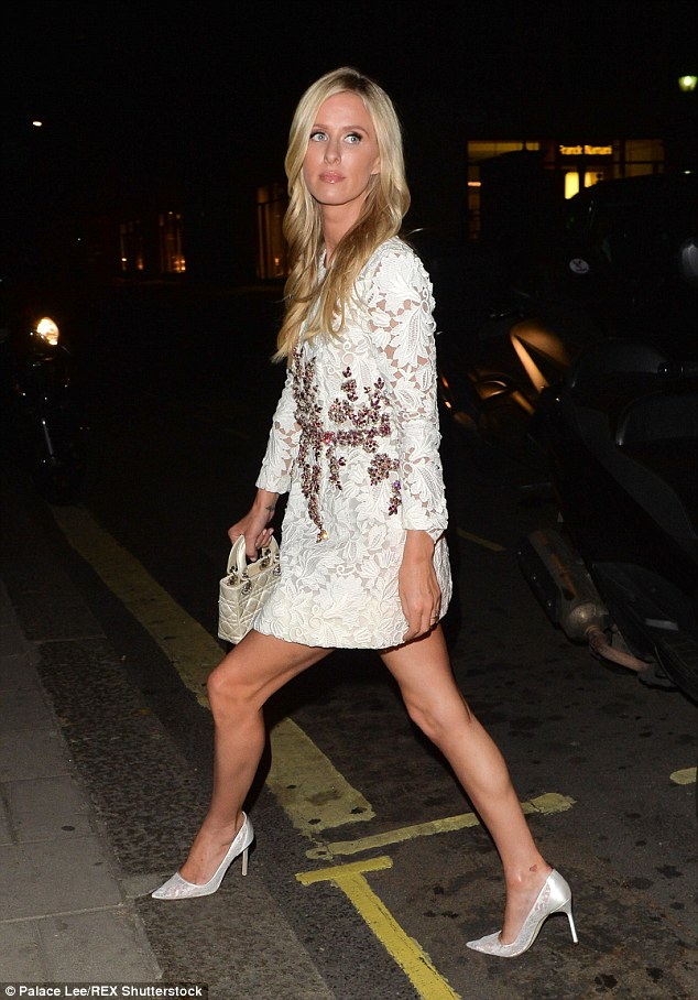 Lunge! Nicky looked impeccable in her fancy white mini dress, complete with decorative embellishments across the torso
