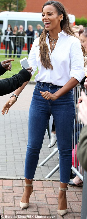 Details: The rare of Rochelle's shirt featured a fringed design which went well with her high waisted jeans