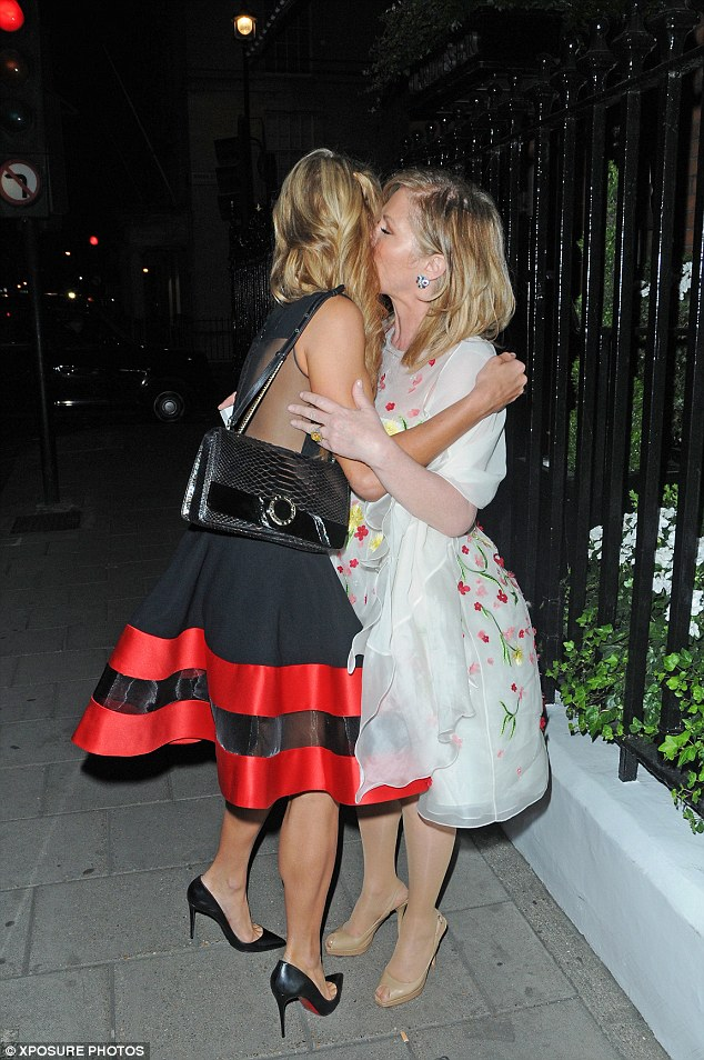 Mwah darling: Paris was receiving a loving kiss on the cheek from her mother as they headed home