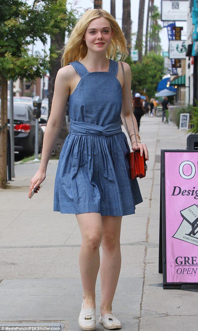 Pamper session! Elle Fanning looked darling in a belted denim dress after getting a manicure in Studio City on Wednesday