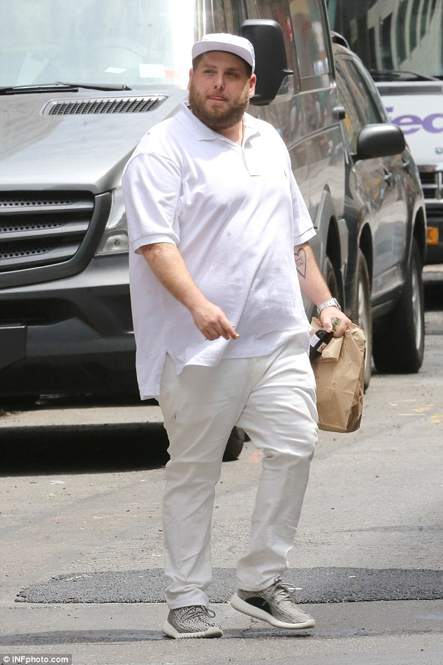 Weight-gain: The twice Oscar-nominated actor showed off his  physique in a white polo shirt and light chinos