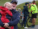 ABERFELDY, SCOTLAND - JULY 11:  Zara Phillips and daughter Mia Tindall (L) support husband Ex England rugby star Mike Tindall (2ndR) and Scottish player Rory Lawson (R), grandson of legendary rugby commentator Bill McLaren, compete in the grueling Artemis Great Kindrochit Quadrathlon in Loch Tay Scotland on July 11, 2015 in Aberfeldy, Scotland.  (Photo by Nigel Roddis/Getty Images for Artemis Quadrathlon)