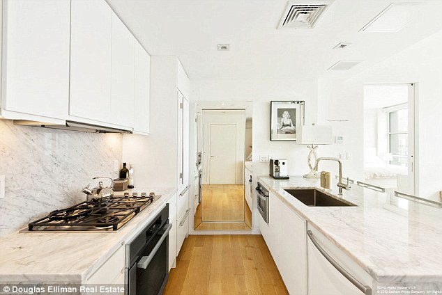 Well appointed: The kitchen features high-end appliances and Carrara marble counters.
