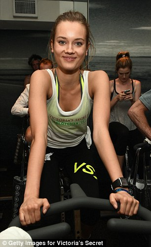 Peace and love:Romee Strijd and Jac Jagaciak showed off their trim figures in matching  vests and personalised leggings