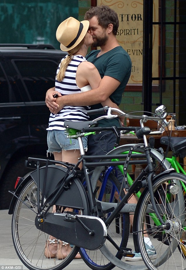 Sweet smooch: Joshua Jackson and his partner Diane Kruger locked lips while out and about in New York City on Wednesday