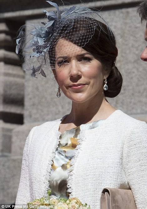 Now and then: Even after meeting Prince Frederik, Princess Mary's style in 2002 (left) remained very different to her present look (right)