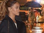 July 9, 2015: Rihanna spotted with umbrella during a rainy evening in New York City.\nMandatory Credit: infusny-260