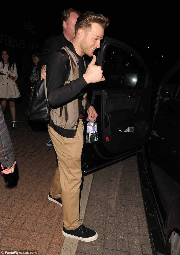 Keeping hydrated: Olly carried two bottles of water into a car and headed for home