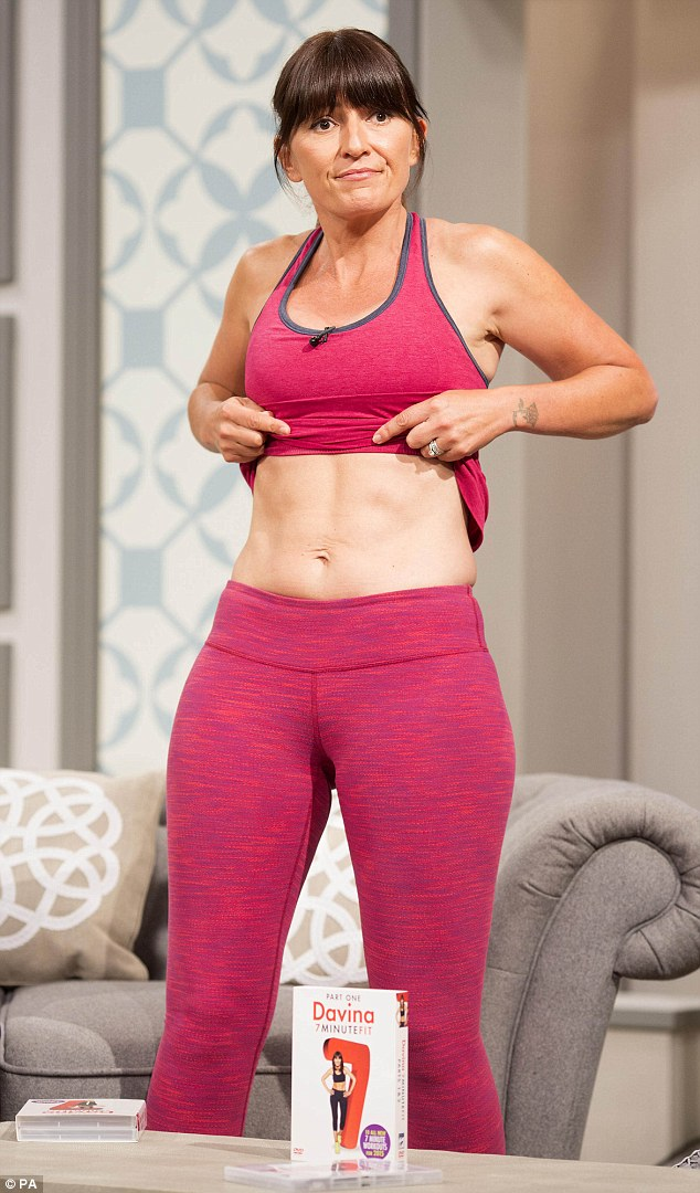 Abs-olutely fabulous! Davina McCall, 47, revealed her awe-inspiring six-pack abs as she lifted up her top while launching her new fitness DVD -Davina 7 Minute Fit: Part 2 - on Wednesday