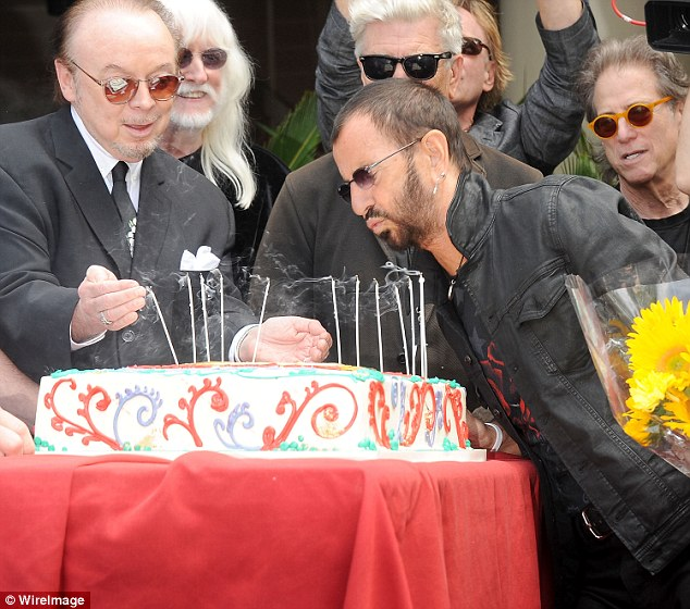Make a wish: After greeting the crowd, Starr blew out the candles on his massive colorful sheet cake