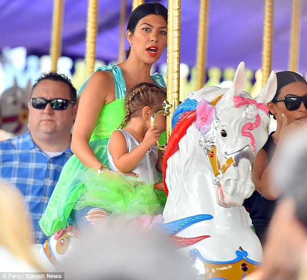 Leaving her problems behind: Kourtney Kardashian took the couple's  daughter Penelope to Disneyland on Wednesday just days after news broke that she has split with Scott