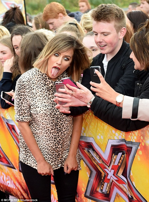 Strike a pose! Flack pulled a funny face as she appeared to send a message out on a fan's phone