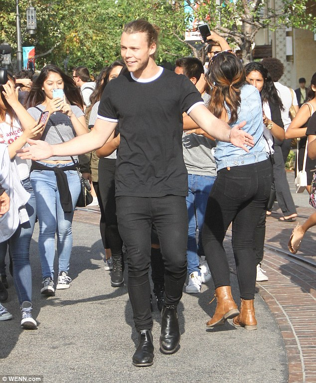 Busy schedule: Ashton Irwin touched down into LAX on Wednesday before heading straight to The Grove shopping centre
