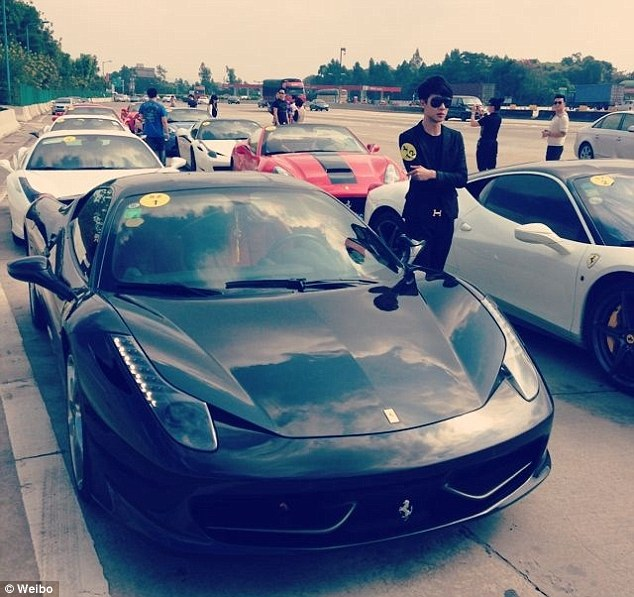 Live fast: Many of them are part of the elusive 'Sports Car Club' where they send images of themselves - standing by their extravagant supercars - to other spoiled children doing the same