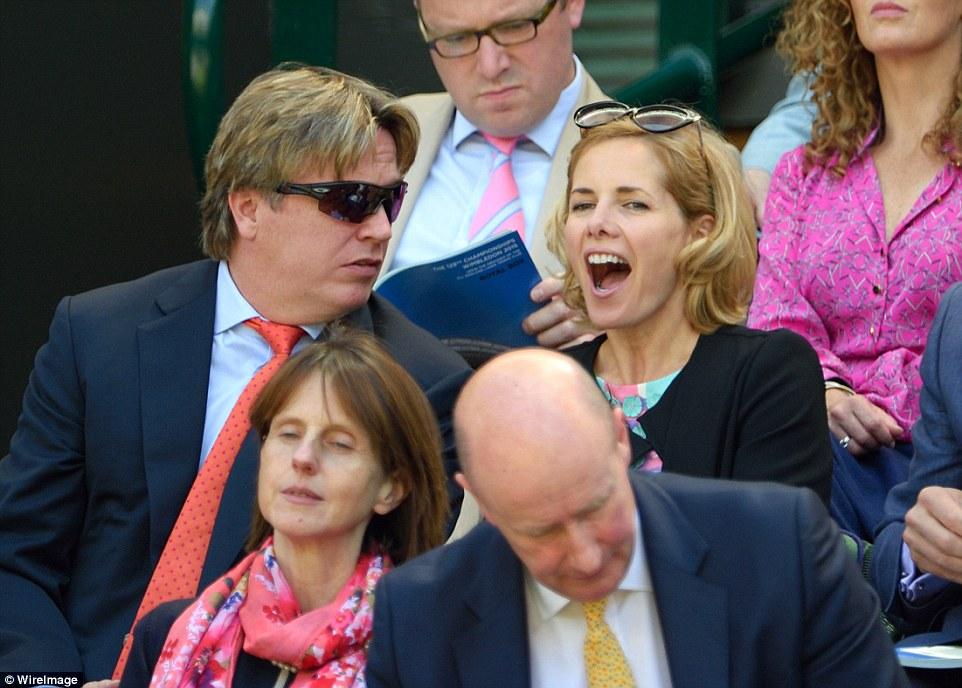 Getting stuck in: Darcey seemed engrossed in the on-court action betweenGarbine Muguruza of Spain and Poland's Agnieszka Radwanska