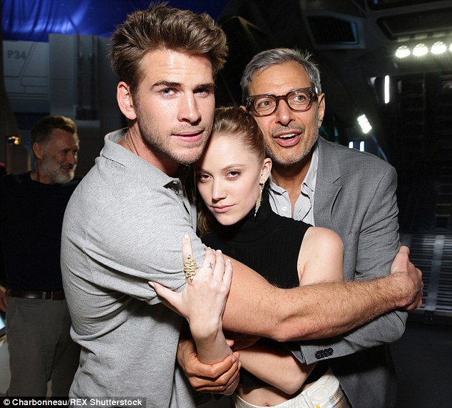 Heating up: According to a source, Liam and his Independence Day: Resurgence co-star, Maika Monroe, were spotted getting flirty at a July 4th party
