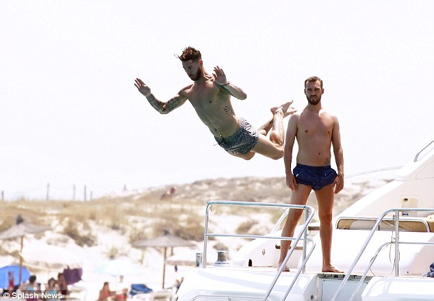 Real Madrid defender Sergio Ramos takes a flier while on holiday in Ibiza with his friends