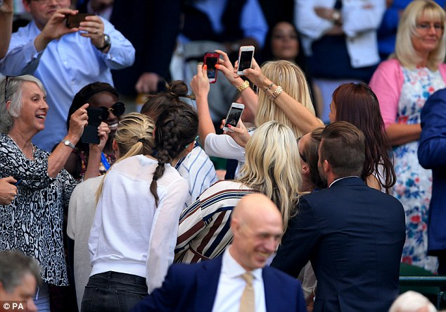 Father of four David had spent much of the afternoon surrounded by excited women, including the England Women's football team who nabbed him for a selfie