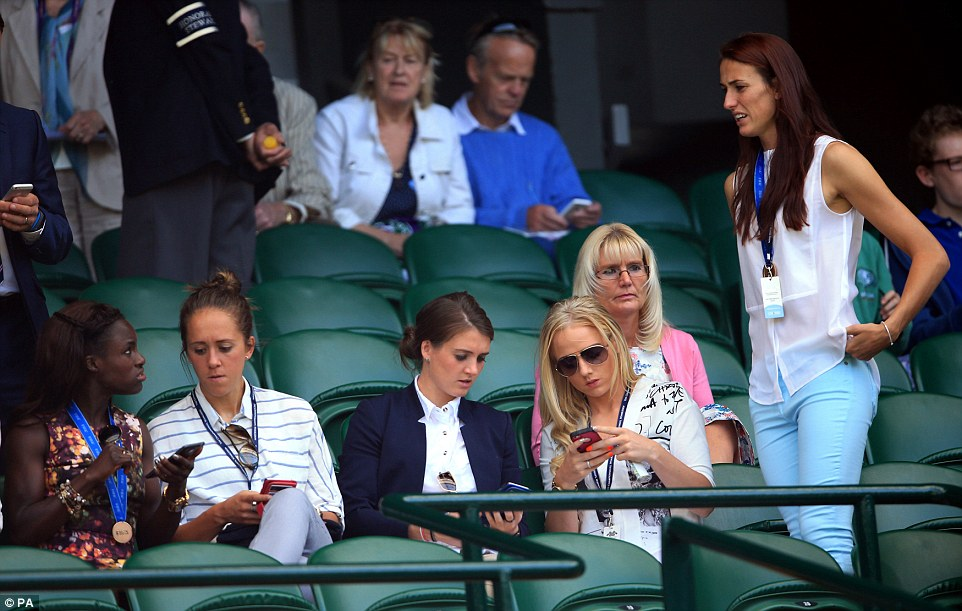 Did you get one? Eniola Aluko, Jo Potter, Jade Moore, Alex Greenwood and Jill Scott compared photos as they sat by centre court