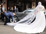 Slight imperfection: There was an awkward moment when a Bentley parked on the train of the dress, trapping the bride outside Claridge's