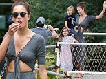 09.JULY.2015 - RIO DE JANEIRO - BRAZIL *** EXCLUSIVE ALL ROUND PICTURES *** *STRICTLY AVAILABLE FOR UK AND GERMANY USE ONLY* ALESSANDRA AMBROSIO TAKES A BREAK FROM FILMING BRAZILIAN SOAP OPERA VERDADES SECRETAS (SECRET TRUTHS) AND SPENDS A FUN FILLED DAY WITH HER KIDS ANJA AND NOAH, AT WORLD'S FAMOUS SUGARLOAF MOUNTAIN, WHERE THE GROUP ENJOYED A FROZEN TREAT AND TOOK SEVERAL FAMILY PICTURES! BYLINE MUST READ : XPOSUREPHOTOS.COM ***UK CLIENTS - PICTURES CONTAINING CHILDREN PLEASE PIXELATE FACE PRIOR TO PUBLICATION *** *UK CLIENTS MUST CALL PRIOR TO TV OR ONLINE USAGE PLEASE TELEPHONE 0208 344 2007*