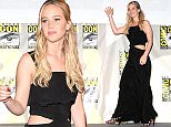 "SAN DIEGO, CA - JULY 09:  Actress Jennifer Lawrence walks onstage at the ""The Hunger Games: Mockingjay Part 2"" panel during Comic-Con International 2015 at the San Diego Convention Center on July 9, 2015 in San Diego, California.  (Photo by Albert L. Ortega/Getty Images)"