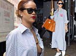 EXCLUSIVE: Rihanna steps out in an oversized shirt dress and Puma sneakers on a rainy day in New York City.  Pictured: Rihanna Ref: SPL1075230  090715   EXCLUSIVE Picture by: TK / JosiahW / Splash News  Splash News and Pictures Los Angeles: 310-821-2666 New York: 212-619-2666 London: 870-934-2666 photodesk@splashnews.com