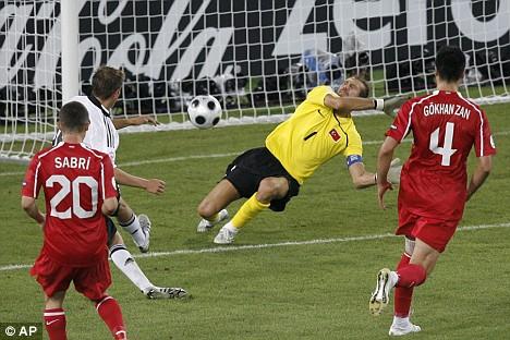 Germany's Philipp Lahm scores past Turkey's Rustu