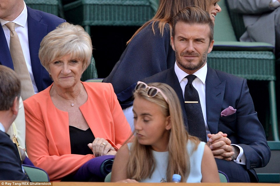 Mingling: Sandra shared a conversation with a fellow spectator as she enjoyed a day with her famous son