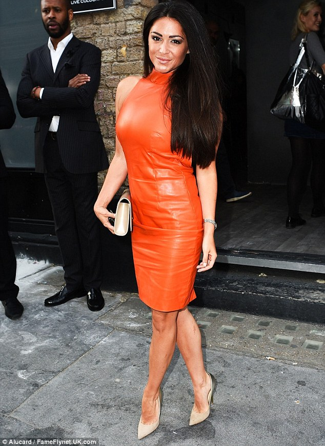 A bright future: The 30-year-old glamour model was a dream in tangerine as she rocked up to the event, slipping her curves into a racy backless orange leather dress for the occasion
