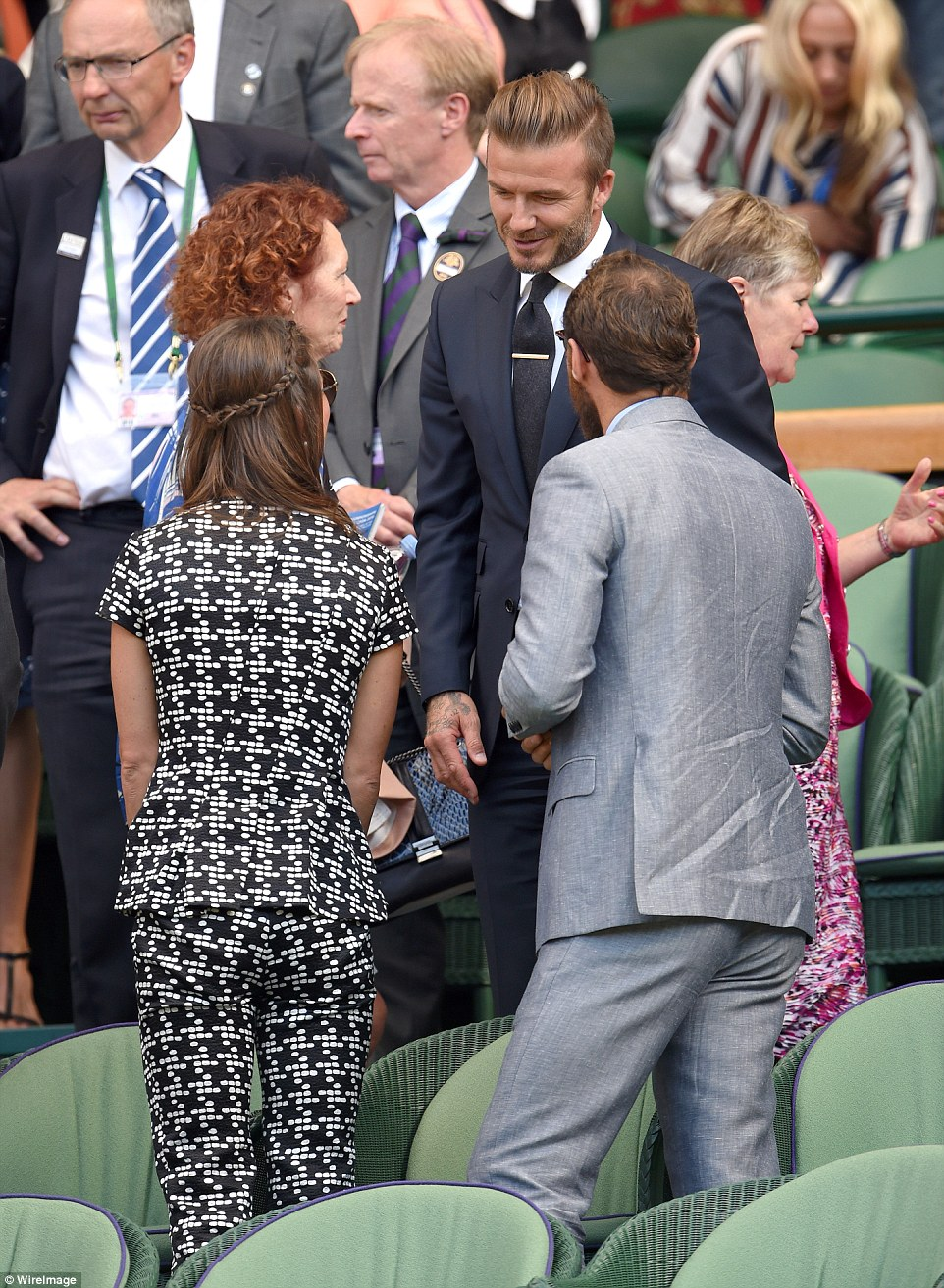 Having a natter: The footballer and the Middleton siblings appeared to have quite a lot to talk about
