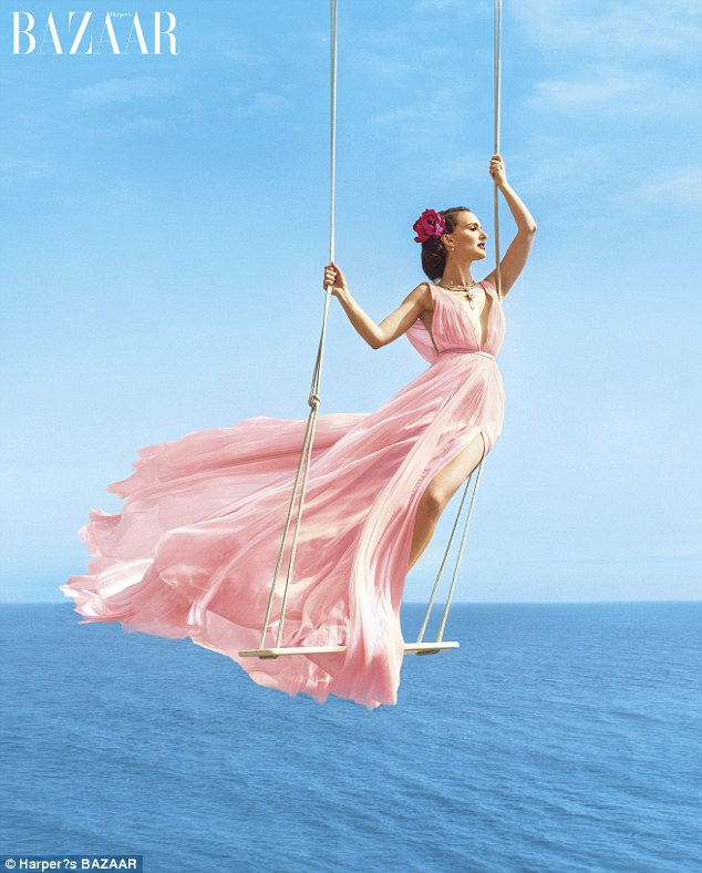 Girl on a swing... over the ocean: Natalie Portman stunned in a pink gown as she posed for the August issue of Harper's Bazaar