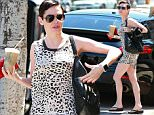 Picture Shows: Rose McGowan  July 10, 2015    Actress Rose McGowan is spotted carrying her new dog Sasquatch in her purse while stopping by Juice Bar in Beverly Hills, California with a friend. Rose is a huge dog lover and also has three Boston Terrier dogs named Bug, Fester, and Happy.    Exclusive  UK RIGHTS ONLY    Pictures by : FameFlynet UK © 2015  Tel : +44 (0)20 3551 5049  Email : info@fameflynet.uk.com