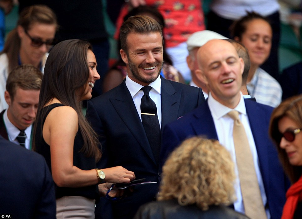 Huge fans: David Beckham chatted to members of the England Women's football squad as he enjoyed another day in the Royal Box at Wimbledon on Thursday