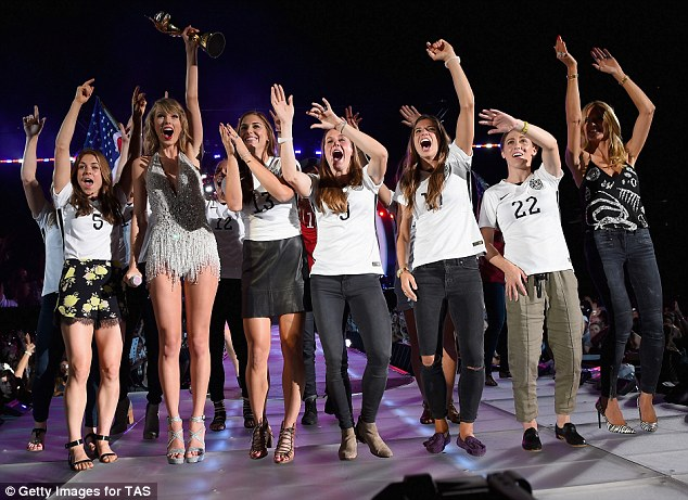 She's a sport! Like a trooper, Taylor honoured the U.S. women's soccer team by bringing them onstage after their World Cup championship
